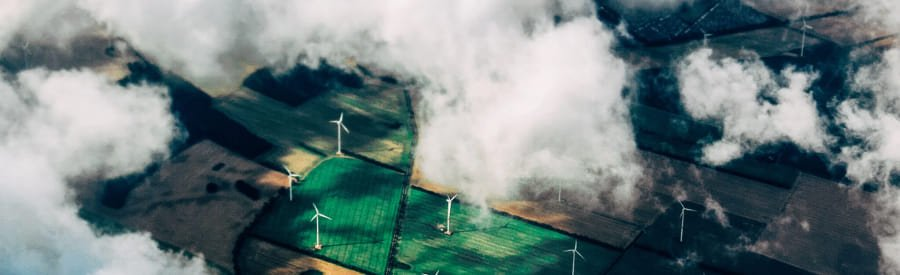 An aerial view of wind power station that can serve as a carbon offset source for Cloverly.