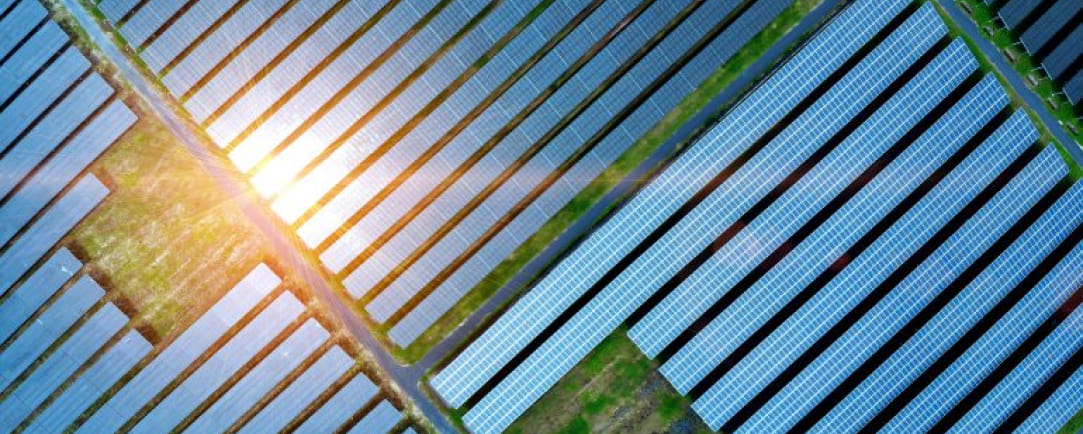 An aerial view of a solar farm that can serve as a source of carbon offsets.