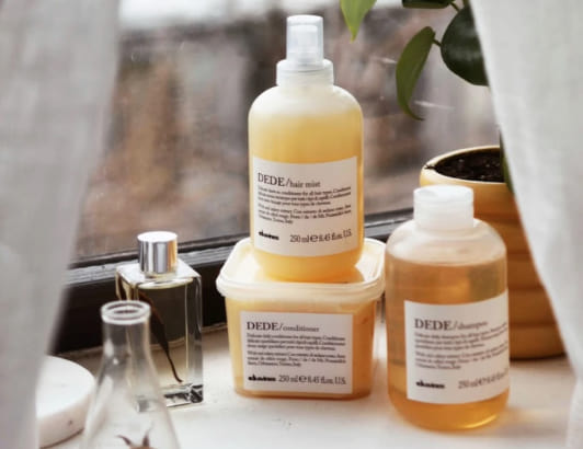Sustainable beauty products from Davines, who uses Cloverly for carbon offsets on online orders.